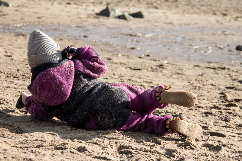 woll-anzug-manitober-sand-strand